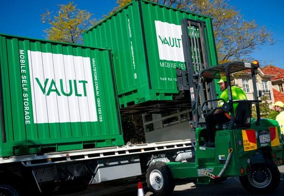 Vault mobile storage container being loaded on to a truck