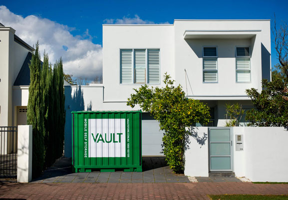 Vault mobile storage container in front of a white house
